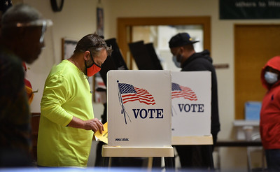 Last-hour voters cast their ballots at Olivet Institutional Baptist Church in Kansas City, Kansas on Tuesday. Election officials there said activity slowed to a trickl in the last few hours.