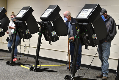 Voters at Indian Creek Technology Center in Overland Park make their selections in Tuesday's election. Officials there reported a light but steady stream of voters early in the day.