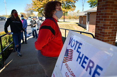 Platte County voters socially distance while waiting in line to enter Heartland Community Church of Christ on Tuesday to cast their vote.