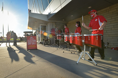 The Kansas City Chiefs Rumble Band perform outside Arrowhead Stadium as voters leave the facilty Tuesday morning.