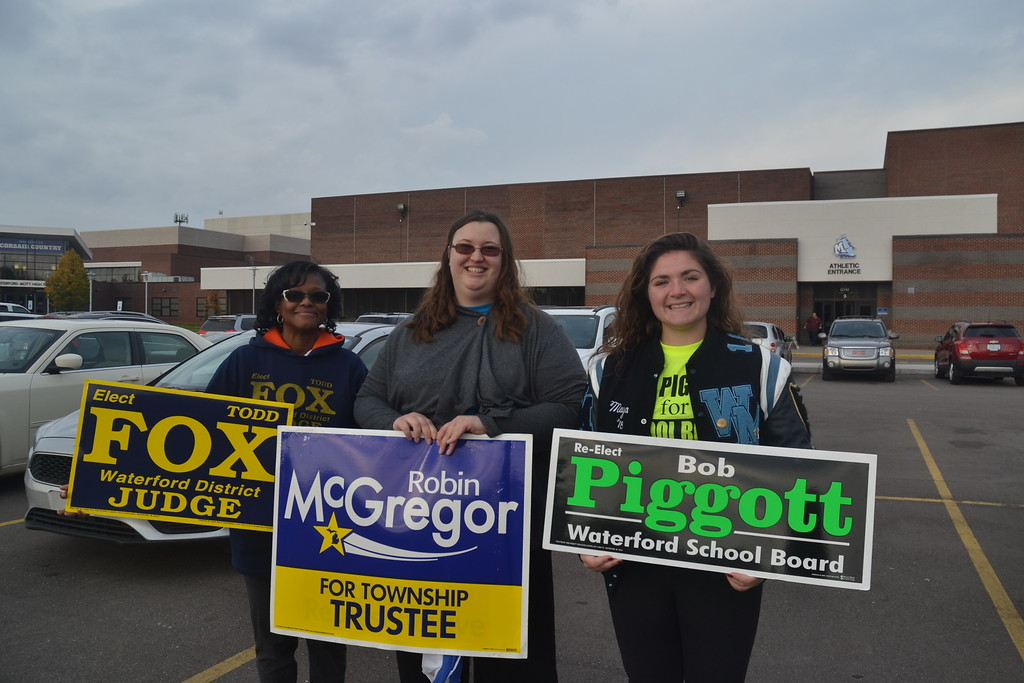 . Annette Agazio, Elizabeth McGregor, and Maya Bourque (left to right) outside campaigning at Waterford Mott High School on Nov. 8, 2016. Anne Runkle / Digital First Media.