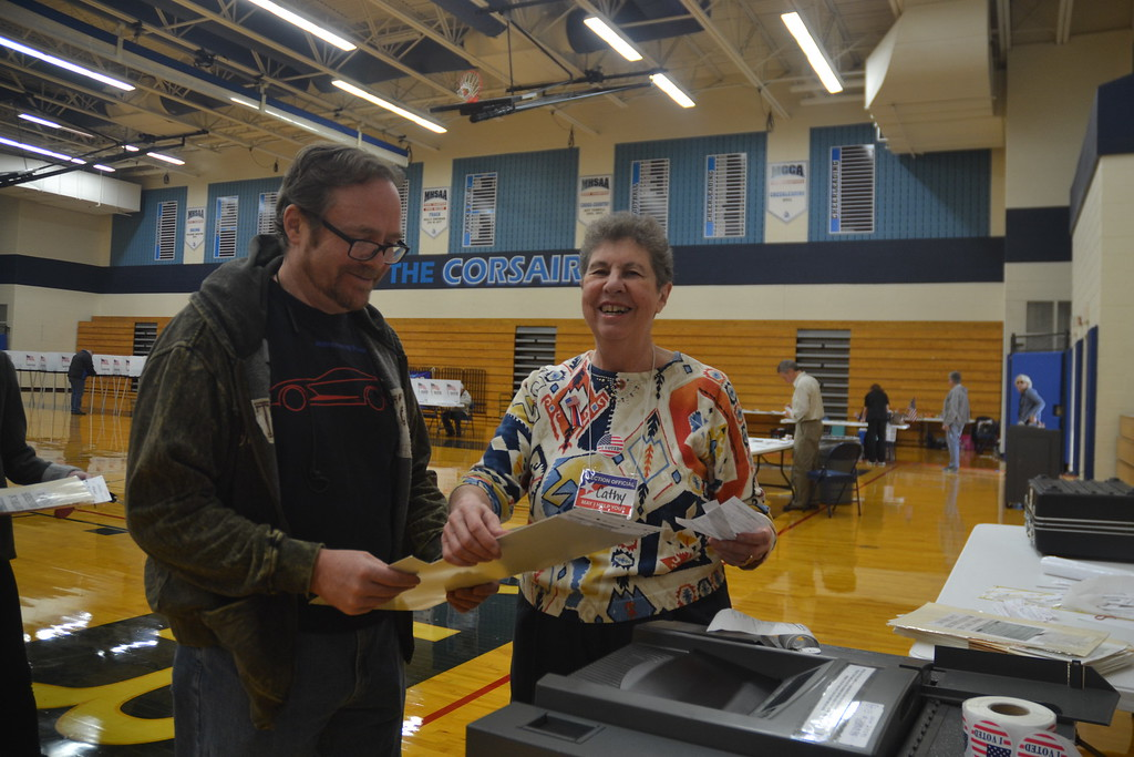 . Dan Lang with Catherine Roller, a poll worker at Waterford Mott High School on Nov. 8, 2016. Anne Runkle / Digital First Media.