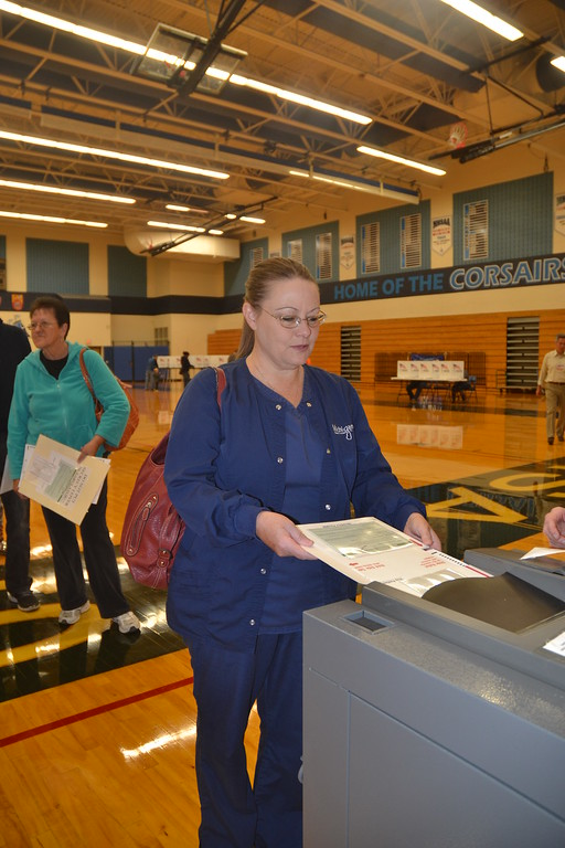 . Mary Ann Bryan finishes her voting at Waterford Mott High School on Nov. 8, 2016. Anne Runkle / Digital First Media.