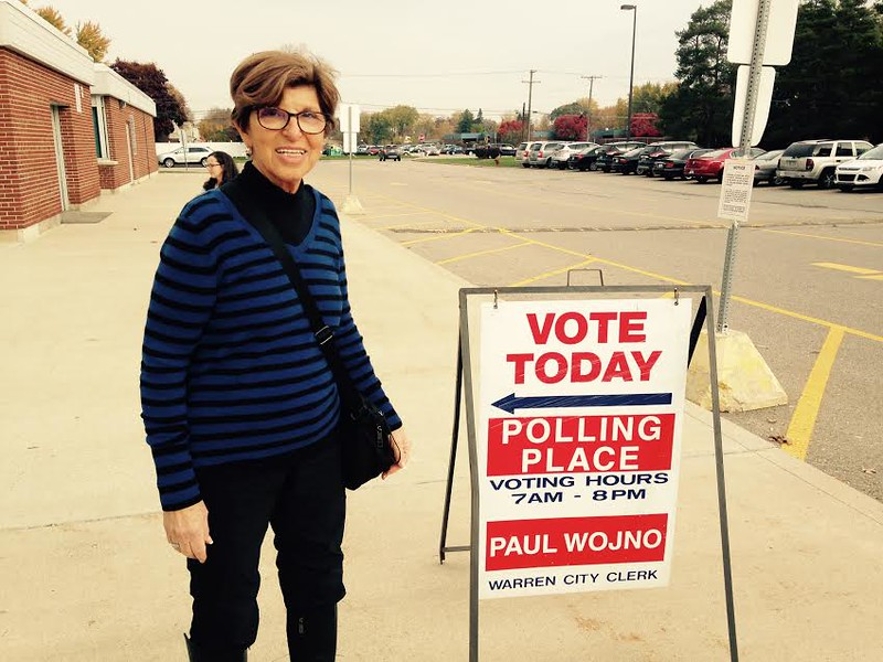 . Retiring Macomb County Clerk Carmella Sabaugh checks in at Precinct 51 in Warren, one of her stops Tuesday morning. (MACOMB DAILY PHOTO BY GINA JOSEPH)