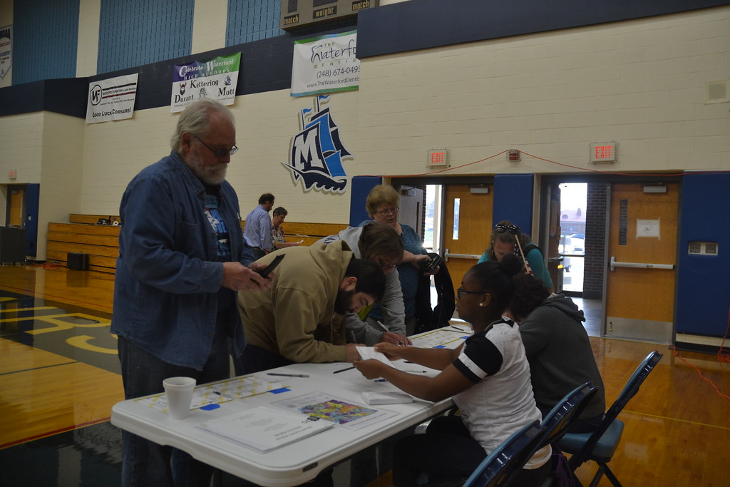 . Voters signing in at Waterford Mott High School on Nov. 8, 2016. Anne Runkle / Digital First Media.