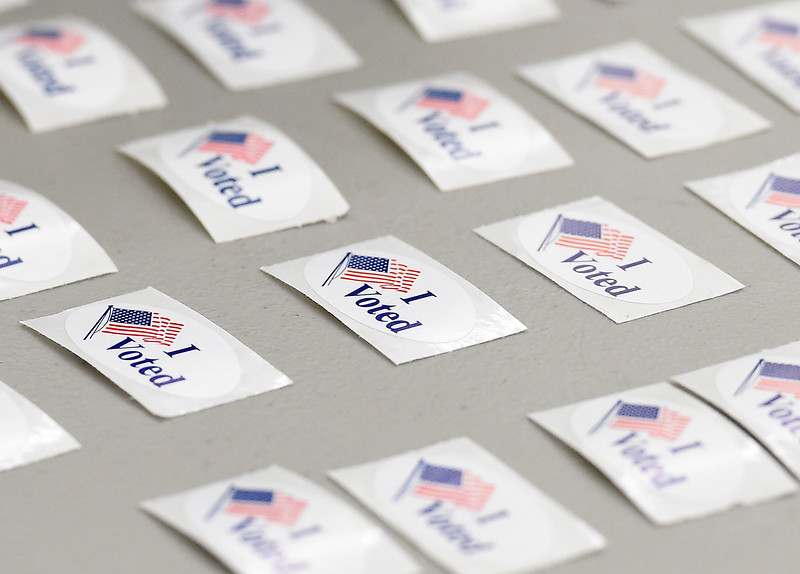 """I Voted"" stickers are lined up on a table on election day, Tuesday, Nov. 8, 2016, at the Police and Courts Building in downtown Loveland. (Photo by Jenny Spaks/Loveland Reporter-Herald)"
