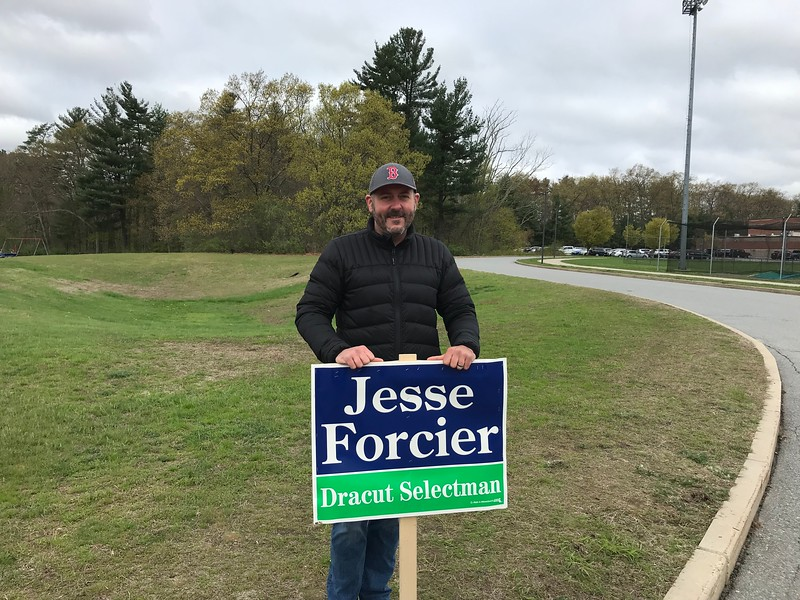 Incumbent Selectman Jesse Forcier campaigns near the entrance to the Justus C. Richardson Middle School in Dracut on Monday. SUN/AMARIS CASTILLO