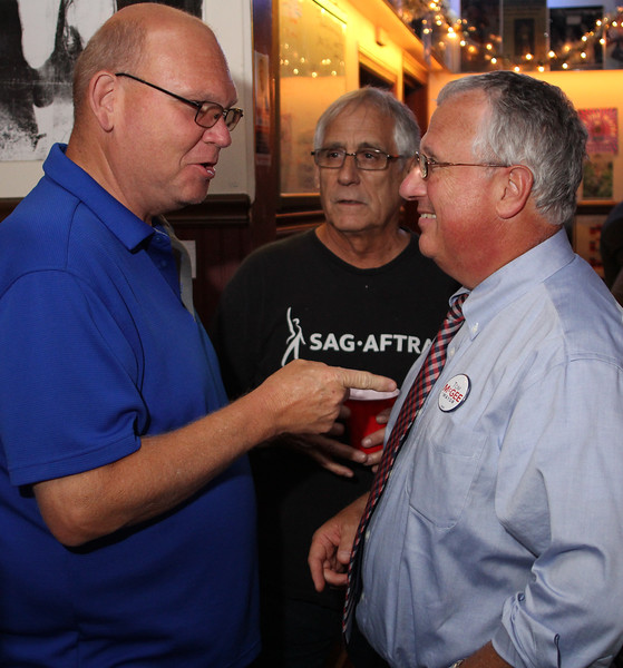 Lynn, ma. 9-12-17. Joe Martin, left, and Louis Rodrigue, middel, congratualte State Senator Thomas McGee on his primiary victory in the Lynn mayoral race.