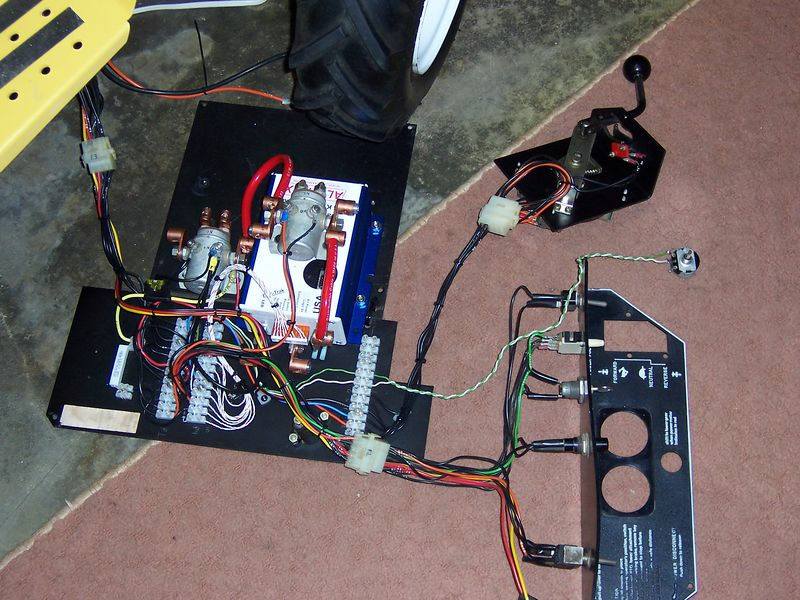 Look closely at the controller pictures and you will get an Idea what I did. Stripped out all the unneeded wiring but kept the small wires to the sensors, dash panel and lights; you can see the original Molex connectors. I used the diagrams that came with the Altrax controller to do all the rest of the wiring. The terminal strips I used were very helpful because you can trace the wiring if repairs are needed. It was an all winter job because I worked on it slowly. Pam was impressed I got it all back together. <br /> <br />  I replaced all the primary wiring and upgraded to new thicker more flexible cable with replaceable connector ends. The battery cables were protected with plastic wire loom. Got rid of the Fuse holder I use inline ATC fuses now.