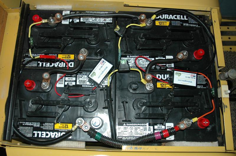 "Golf Cart ""Wizbang"" Battery Desulfator, Amazon sells them, strange name but seems to work OK."
