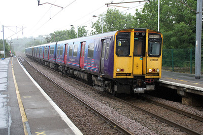 313058 arrives at Hertford North in the rain on a Kings X service 04/06/12