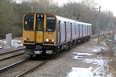 313047 approaches Bayford with a Hertford-Moorgate service.  17/01/13.
