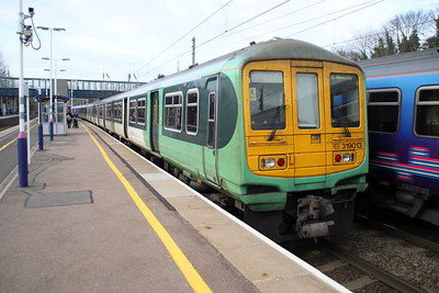 319013 on a Bedford service at Harpenden 08/03/12