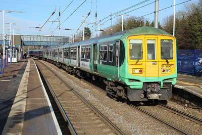 319011 still in Southern Livery forms a service to Brighton at Harpenden 08/02/13.