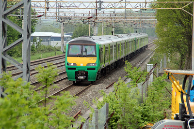 321414 approaches Kings Langley on a London Midland working to Euston. This was taken from the multi storey. 20/05/13.