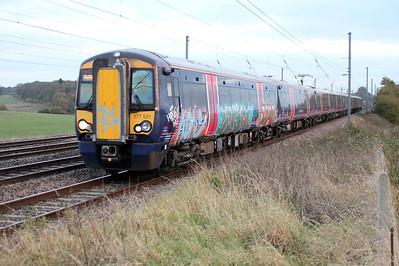 377521 passes Ayres End Lane, Harpenden 07/11/12.