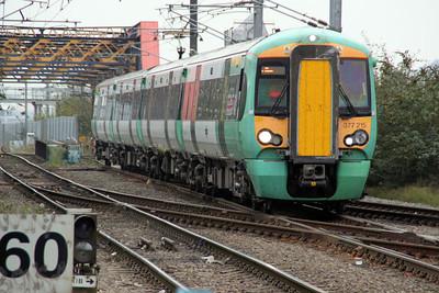 377215 Heads to Watford through Mitre Bridge. 16/10/11