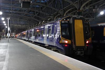 380115 arrives at Glasgow Central.