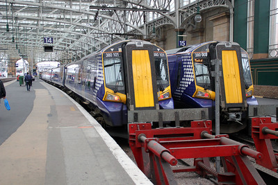 380101 and 380003 at Glasgow Central.