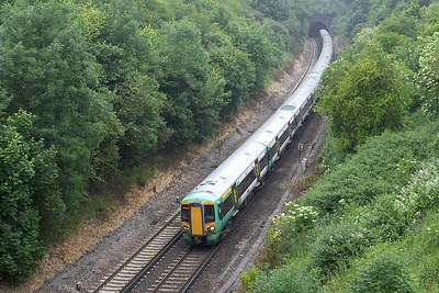377150+377128+377112 form 1H14 1117 London Victoria-Southampton Central seen exiting Quarry Tunnel on 20/06/2005. A portion of the train would be detached at Haywards Heath and run to Eastbourne.