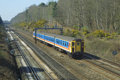 Class 421/5 4-CIG, 1307 nears Pirbright Junction on 04/04/2003.
