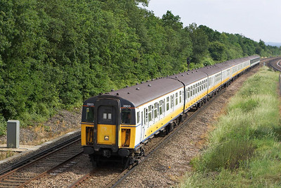 Class 423/9 4-VOP leads two Class 421/3 4-CIG's, 3903/1866/1862 head towards the Capital at Salfords on 20/06/2005.