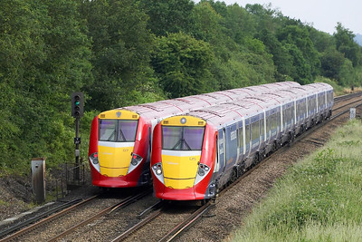 Gatwick Express units meet at Salfords on 20/06/2005. 460005 forms 1U70 1720 Gatwick Airport-London Victoria as it passes 460007 working 1D69 1700 London Victoria-Gatwick Airport.