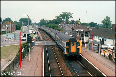 4TC set 429 leads a formation propelled by 33102 forming 1W30 1348 Weymouth-London Waterloo arriving at Wool on 10/08/1986.