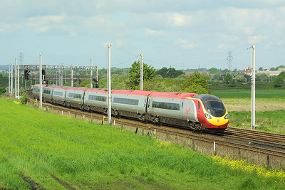 390016 forms 1C14 1210 Stafford-Lancaster at Winwick Jnct on 15/05/2004 vice an HST set.