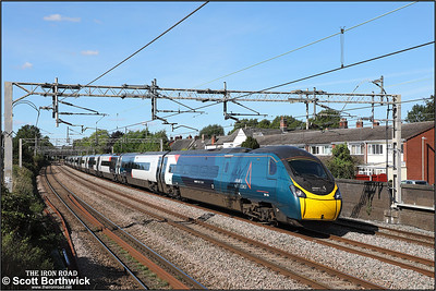 390136 'City of Coventry' passes Westwood Road, Atherstone working 1M11 1040 Glasgow Central-London Euston on 20/09/2021.
