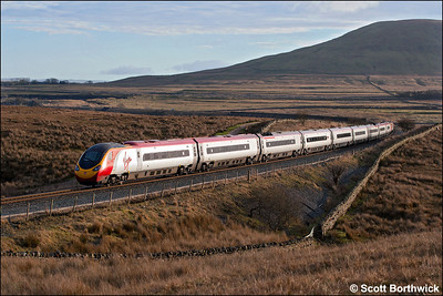 390022 is dragged across Blea Moor by 57303 'Alan Tracy'  whilst working 1M16 1140 Glasgow Central-London Euston on 21/01/2006. The train is about to cross Ribblehead Viaduct.