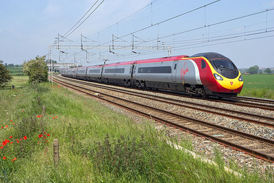 390035 is seen at speed passing Grendon on 05/06/2006 whilst forming 1A51 1129 Lancaster-London Euston.