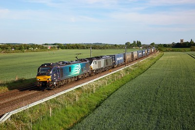 DRS 88005 'Minerva' leads 68015 both powering 4Z45 Daventry to Mossend at South Muskham, Newark on 25 May 2020