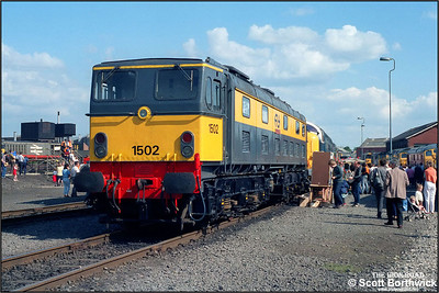 1502, formerley E27000 'Electra', is exhibited at Coalville Mantle Lane's 'Open Day' on 31/05/1987 sporting its Dutch Railways livery after returning to the UK for preservation. Built by Metropolitan-Vickers between 1953 & 1954 for use on the Trans Penine Woodhead Route between Manchester and Sheffield, the class was withdrawn during 1968 and sold to the Dutch national railway operator Nederlandse Spoorwegen the following year where they gained useful employment until 1986.