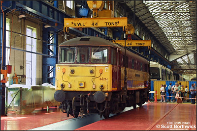 Although at the time stored due to transformer defects, 86261 'The Rail Charter Partership' was used to demonstrate how a loco is lifted from its bogies during the 2003 Crewe Works Open Weekend. Several displays were given throughout each day of the event and here the loco is seen prior to being lifted on 31/05/2003.