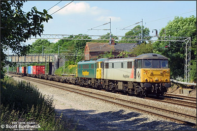 86638+86605 pass Cathiron with 4L75 1014 MX Trafford Park-Ipswich Yard on 07/06/2004 running additionally on a Monday.