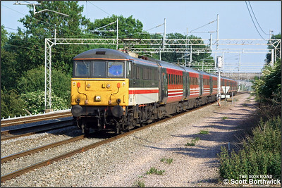 86228 'Vulcan Heritage' passes Cathiron whilst in charge of 1F21 1700 London Euston-Liverpool Lime Street on 13/06/2003.