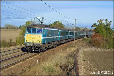 86238 'European Community' passes Dagworth whilst working 1P25 0940 Norwich-London Liverpool Street on 25/10/2003.