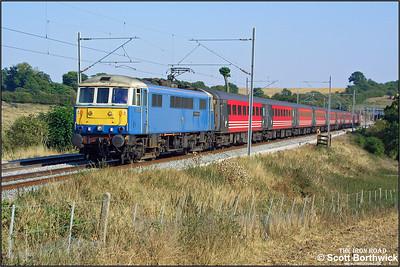 86233 'Alstom Heritage' works 1C20 1530 London Euston-Carlisle at Weedon Bec on 04/09/2003.