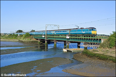 86235 'Crown Point' propels 1P48 1800 London Liverpool Street-Norwich across the River Stour Viaduct, Manningtree on 06/07/2004.
