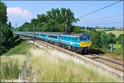 86235 'Crown Point' speeds past Brantham with 1P49 1540 Norwich-London Liverpool Street on 06/07/2004.