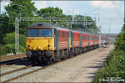87014 'Knight of the Thistle'+86247'Abraham Darby' head north at Cathiron with a Virgin West Coast service from London Euston on 13/07/2002.