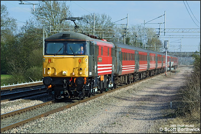 87019 'Sir Winston Churchill' looks immaculate after a partial repaint passing Cathiron whilst working 1C20 1530 FSX London Euston-Carlisle on 08/04/2003.