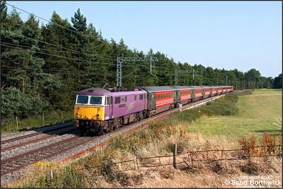 87002 'The AC Locomotive Group' passes Brockhall, Northants with 1G21 1652 London Euston-Birmingham New Street on 12/07/2006.