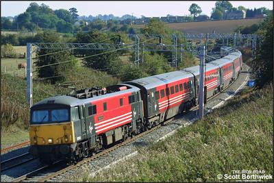87012 'Coeur De Lion' speeds northwards at Dodford on 17/09/2003.