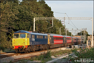 As the sun sets and shadows lengthen, 87006 approaches Berkswell whilst working 1G21 1652 London Euston-Birmingham New Street on 15/09/2006.