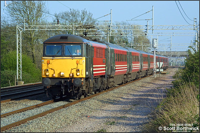 87024 'Lord of the Isles' races northwards at Cathiron with 1S86 1630 London Euston-Glasgow Central on 19/04/2002.