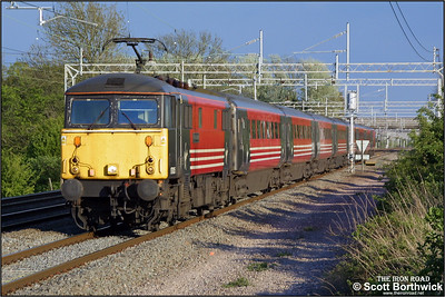 87005 'City of London' speeds north at Cathiron with a service from London Euston on 02/05/2002.