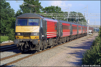 90011 works a Virgin West Coast service northwards at Cathiron on 13/07/2002.