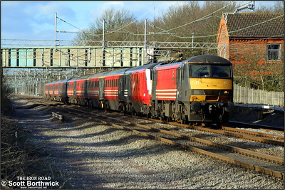 90012 'British Transport Police' heads for London Euston at Cathiron on 04/02/2003. On the date this photograph was taken, Scotland was experiencing severe adverse snowy weather and locomotives were required to haul, rather than propel trains. This resulted in a number of sets either having the locomotive hauling the DVT or the set facing the wrong way if it had been turned, resulting in the locomotive being on the London end of the train, rather than the usual country end.